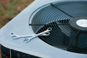 outdoor-ac-unit-with-tools-resting-on-top